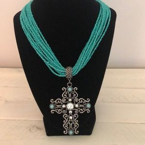 Beautiful turquoise color beaded necklace/cross